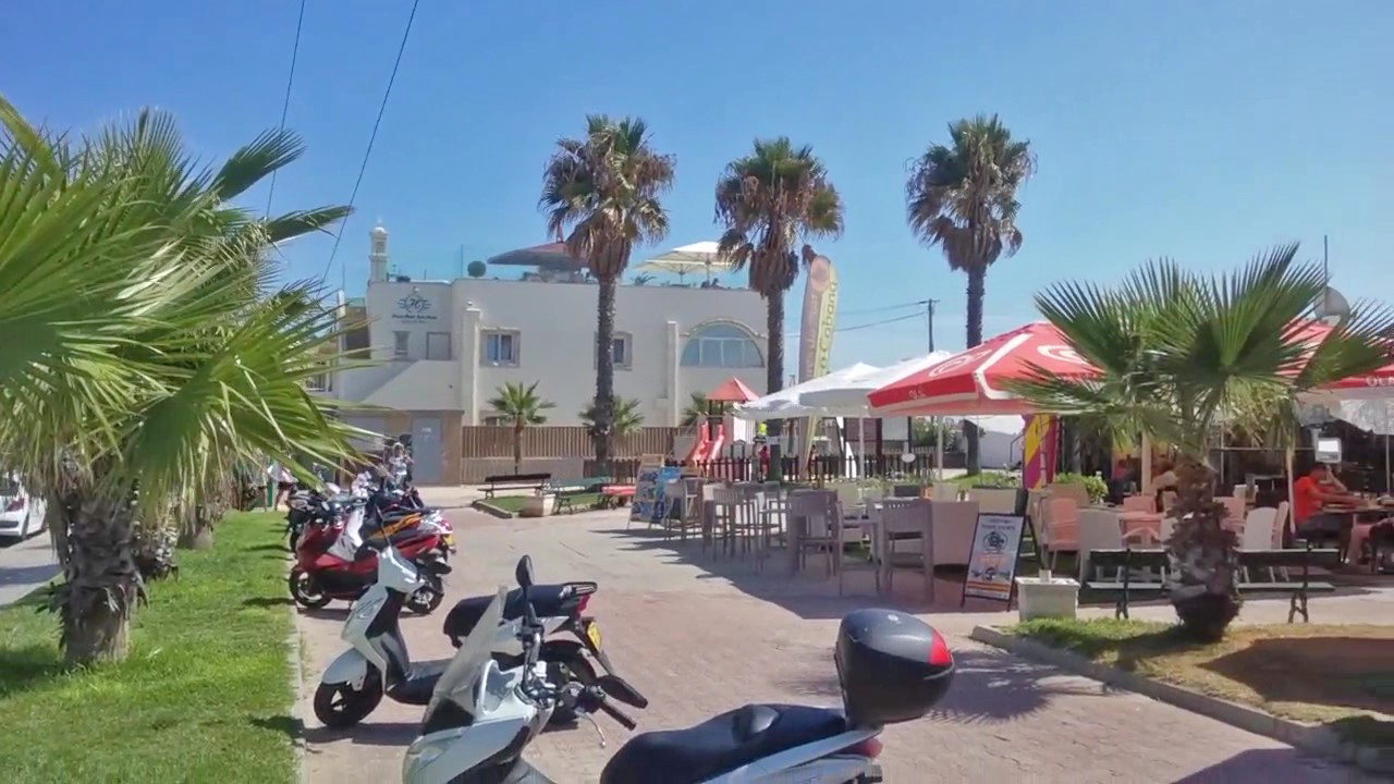 Snack bars in the square on Faro Beach