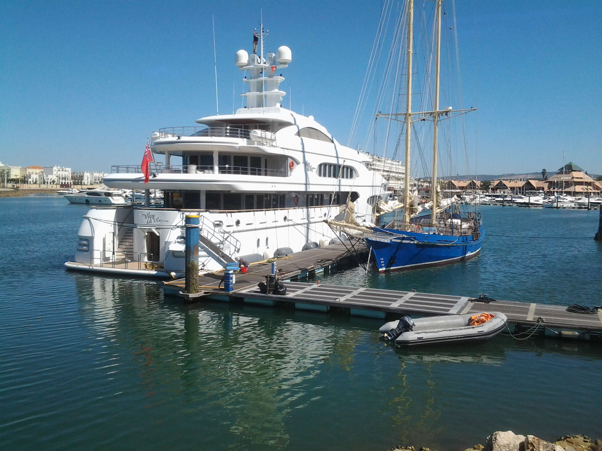 a very large luxury yacht at Vilamoura Marina, Algarve, portugal