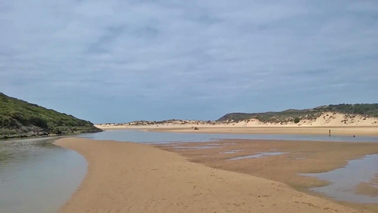 Sand flats and dunes along the Aljezur river at Praia da Amoreira, Algarve, Portugal