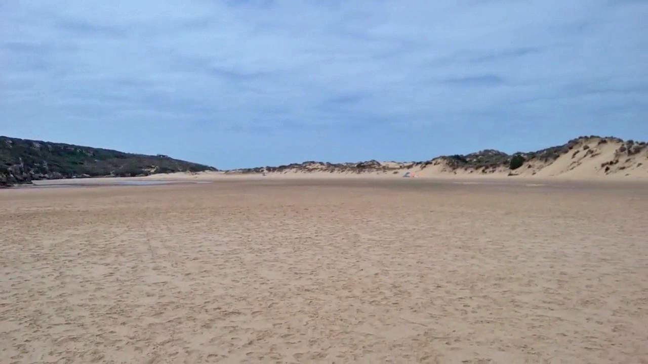 sand flats, dunes and river at Praia da Amoreira, Aljezur, Algarve, Portugal
