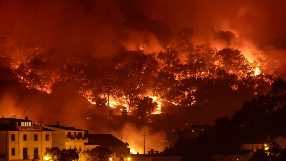wildfire surrounds the town of Monchique, Algarve, Portugal